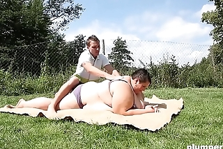 Huge fat unspecific face sits on young stud and sucks him lacking