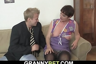 Old woman enjoys riding his young cock