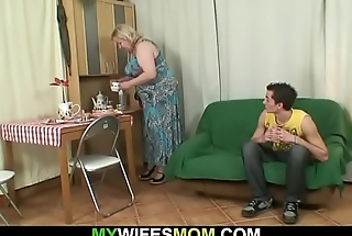 He fucks huge mom-in-law and gets busted by wife
