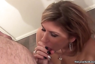 Classy MILF not afraid to take facial cum off strangers