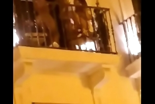 British girl akin her tits on a balcony in Pamplona