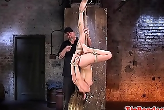 Suspended BDSM babe gagged with dildo