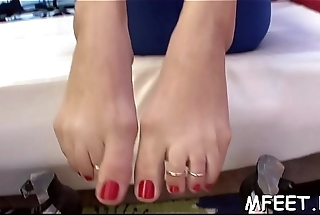 Nasty guy seems to enjoy worshiping his sexy babe'_s feet very much