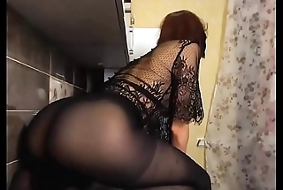 Naughty brunette in sexy pantyhose