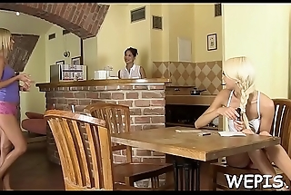 Lad is pissing in a glass, and his whore is drinking his urina